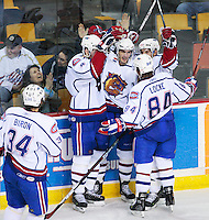 April 28, 2007; Hamilton, ON, CAN; Hamilton Bulldogs centre (26) Maxim Lapierre, centre, celebrates his third period goal with teammates defenceman (34) Mathieu Biron, defenceman (4) Dan Jancevski, right winger (19) Duncan Milroy and centre (84) Corey Locke during game six of the AHL north division semifinal against the Rochester Americans at Copps Coliseum. The Bulldogs won 6-2 and eliminated the Americans from the playoffs. Mandatory Credit: Ron Scheffler, Special to the Spectator. (File number RRSA8481).