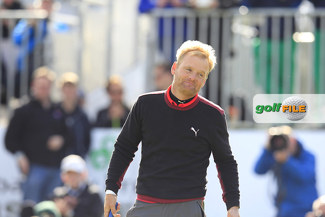Soren KJELDSEN (DEN) sinks his putt on the 18th green playoff hole to win the tournament at the end of Sunday's Final Round of the 2015 Dubai Duty Free Irish Open, Royal County Down Golf Club, Newcastle Co Down, Northern Ireland 5/31/2015.<br /> Picture Eoin Clarke, www.golffile.ie