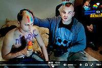 "A still from a video made by members of 'Occupy Pedophilia', a militantly homophobic group that specialises in hunting and filming violent attacks on suspected gays and pedophiles (the group believes that gays and pedophiles are almost equally immoral and that most gays are pedophiles and vice-verse). On the popular online TV-show 'Occupy Pedophilia' victims are tricked into false dates. But instead of a romantic encounter, this band of armed ultra-nationalists are lying in wait. Once caught and confronted the victim is sexually humiliated and tortured, while everything is filmed, posted publicly and shared online. According to the group more than 70 videos have been made so far - with more to come. This video shows an unidentified man who has had 'FAGGOT"" written on his chest being filmed by a gang of men. The TV station's logo, in the corner, bears the title 'NETTING THE FAGGOTS!'. (MANDATORY CREDIT   photo: Mads Nissen/Panos Pictures /Felix Features)"
