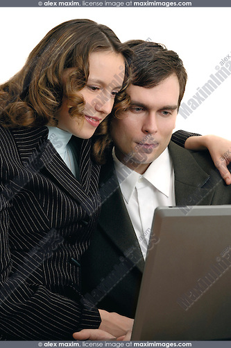 Young happy couple sitting together with a laptop computer on their laps looking with a smile on the display Conceptual emotional photo Isolated on white background Vertical orientation