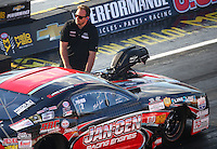Sep 2, 2016; Clermont, IN, USA; Crew member Mike Janis Jr guides his father NHRA pro mod driver Mike Janis to the starting line during qualifying for the US Nationals at Lucas Oil Raceway. Mandatory Credit: Mark J. Rebilas-USA TODAY Sports
