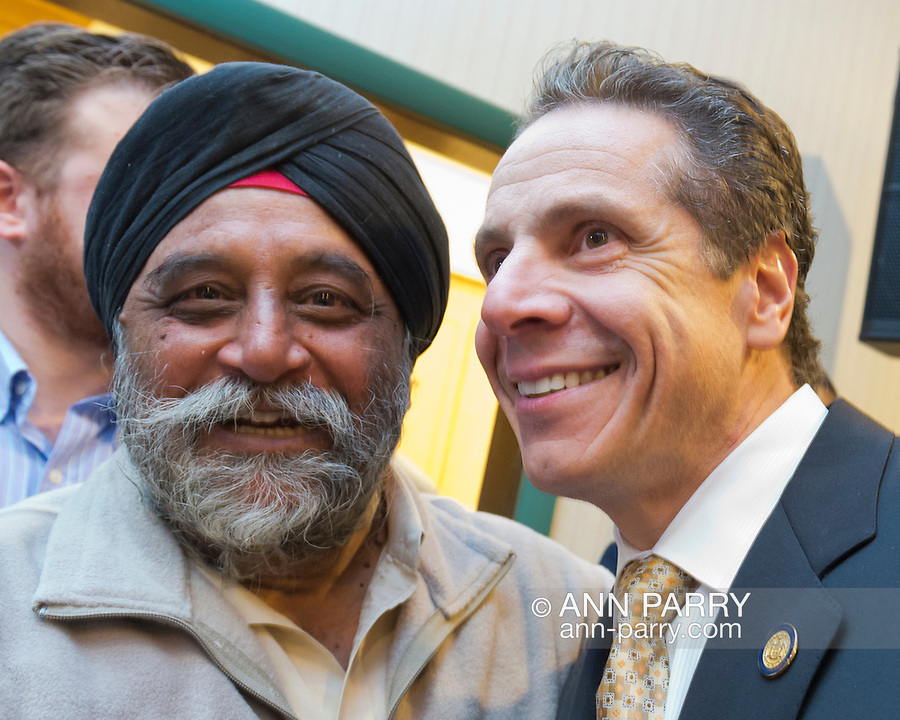 Albertson, New York, U.S. 26th October 2013. New York Gov. ANDREW CUOMO poses with MOHINDER TANEJA after the governor endorses TOM SUOZZI for Nassau County Executive, at the Albertson Veterans of Foreign Wars VFW Post. Democrat Suozzi, the former Nassau County Executive, and Republican incumbent Mangano face each other in a rematch in the upcoming November 5th election.