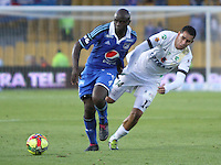 BOGOTA -COLOMBIA. 03-05-2014. Modeste M´Bami  (Izq) de Millonarios  disputa el balon contra Jhon Valencia de La Equidad  partido de vuelta por los Cuartos de Final  de La liga Postobon  disputado en el estadio Nemesio Camacho El Campin. /   Modeste M´Bami (L) of Millonarios dispute the balloon against Jhon Valencia of La Equidad  game around the Quarter Finals of the Postobon league match at the Estadio Nemesio Camacho El Campin. Photo: VizzorImage/ Felipe Caicedo / Staff