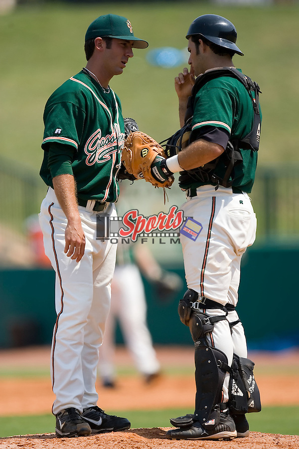 Daniel Santin (7) has a chat with relief pitcher Jay Buente (10) at First Horizon Park in Greensboro, NC, Wednesday, August 15, 2007.