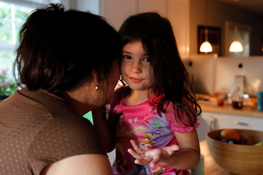 Mailynn tells Ava a secret Shurtleff at home in Charlottesville, VA. Photo/Andrew Shurtleff
