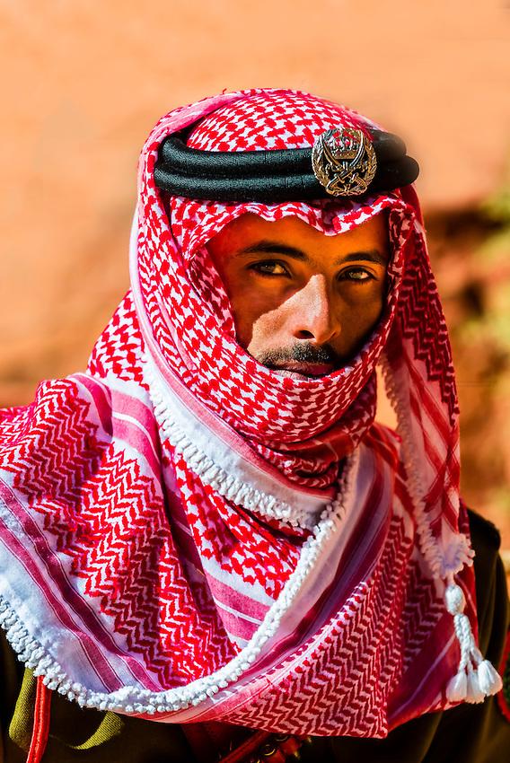 A Bedouin Desert Patrol policeman at the Treasury monument (Al-Khazneh), Petra archaeological site (a UNESCO World Heritage site), Jordan.