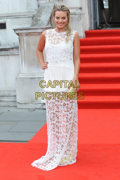 Margot Robbie <br /> attends the World Premiere of &quot;About Time&quot;, Somerset House, London, UK, 8th August 2013.<br /> full length white crochet lace sheer dress sleeveless long maxi hand on hip gold clutch bag <br /> CAP/BEL<br /> &copy;Tom Belcher/Capital Pictures