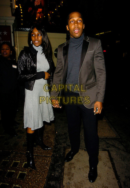 "LEMAR OBIKA & GUEST.""Guys & Dolls"" VIP Performance, Picadilly Theatre, London, UK..January 24th, 2007.full length grey gray suit jacket black trousers holding hands dress boots .CAP/CAN.©Can Nguyen/Capital Pictures"