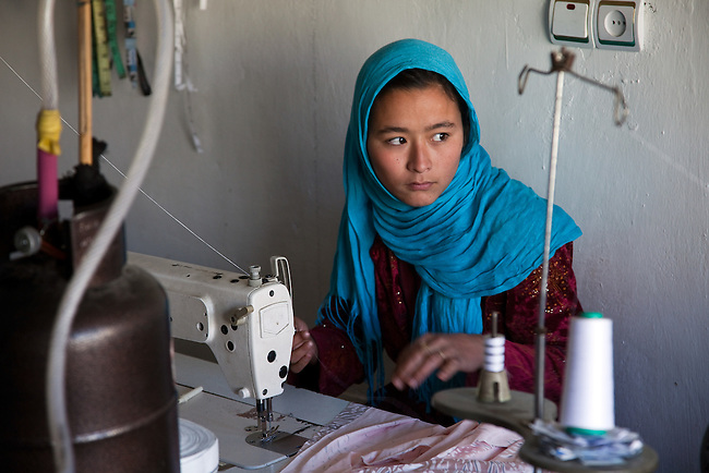09 May 2012, Bamiyan, Afghanistan : Sixteen year old Sakina Ibrahimi   who works as a dressmaker at Poshak Jawanan tailoring at Mullah Ghulam village on the outskirts of Bamiyan. Her older sister Massoma is a part owner of the business. Poshak Jawanan is a small business venture looking to grow and expand both its workforce and output. It is benefiting from the Afghan Rural Enterprise Development Program (REDP). It has been in the program for three months and is hoping to find larger space to get more workers but is hamstrung by the lack of city power to drive its machinery. .The World Bank is funding the REDP in conjunction with the Afghan Government by providing assistance with training for employees, marketing for the products and arranging access to finance to expand and grow the small business venture . Picture by Graham Crouch/World Bank