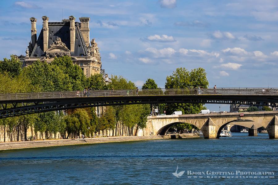 Paris, France. View from a boat on the river Seine. View east with Passerelle Léopold-Sédar-Senghor footbridge, towards Pont Royal and Pavillon de Flore, part of Louvre.