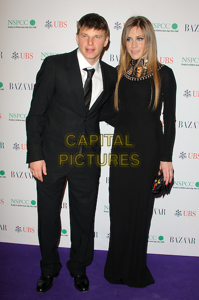 ANDREY ARSHAVIN & GUEST.The Surrealist Ball in aid of NSPCC at The Banqueting House, London, England..March 17th, 2011.full length suit maxi dress black white.CAP/CJ.©Chris Joseph/Capital Pictures.