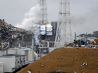 A handout image made available 16 March 2011 by Japanese Fukushima nuclear plant operator Tokyo Electric Power Co (TEPCO), showing the destruction and white smoke from reactor block 3 (L) and remains of reactor block number 4 (R), after both blocks suffered heavy damage following explosions. White smoke was seen rising from reactor number 3 at the plant in Fukushima that is home to six reactors after a fire broke out for a second day at reactor number 4. About 50 workers remained at the plant to try to cool down the reactors. Radioactive emissions at the plant reached record levels<br /> overnight. The inner shell of a quake- and tsunami-damaged nuclear reactor in Japan might be damaged and radiation was so high there that employees were ordered out of the complex, the<br /> government?s top spokesman Chief Cabinet Secretary Yukio Edano said.  /TEPCO/HANDOUT  EDITORIAL USE ONLY/NO SALES