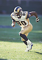 St. Louis Rams, Isaac Bruce (80) during a game against the New York Jets on October 21, 2001 at Giants Stadium in East Rutherford, New Jersey.  The Rams beat the Jets 34-14. Isaac Bruce played for 16 years with 2 different teams and was a 4-time Pro Bowler.