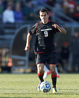 Northeastern University forward Donovan Fayd'Herbe de Maudave (9) brings the ball forward. .NCAA Tournament. University of Connecticut (white) defeated Northeastern University (black), 1-0, at Morrone Stadium at University of Connecticut on November 18, 2012.
