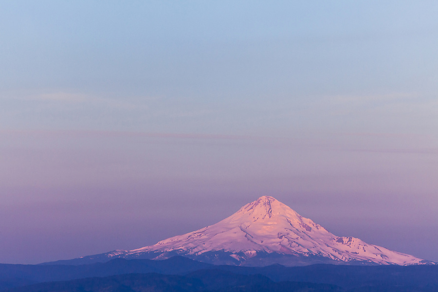 Colorful morning light blankets Mount Hood in pastel colors at dawn.