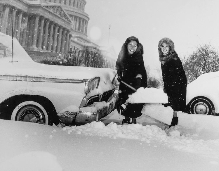 Rep. Charlotte Thompson Reid, R-Ill., removing snow from in front of her car on Capitol Hill in 1963. (Photo by CQ Roll Call)