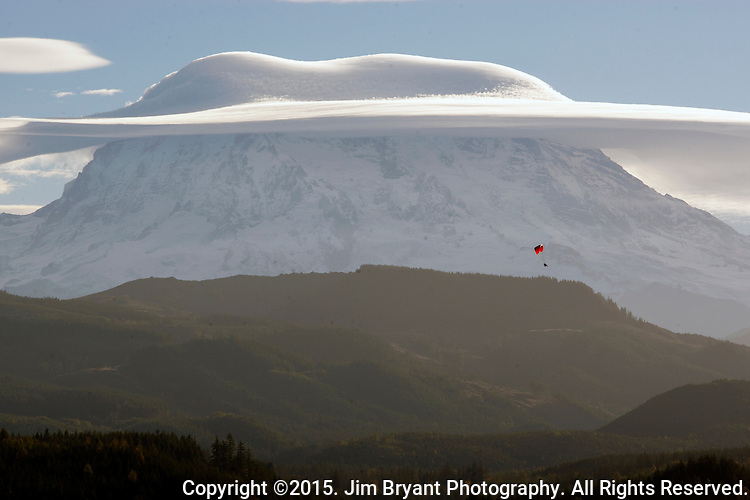 Mt. Rainier, with lenticular clouds. The 14,411 foot volcano which covers 228,480 acres was designated a National Park in 1899. Washington.  Jim Bryant Photo. ©2015. All Rights Reserved.