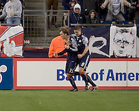 New England Revolution forward Zack Schilawski (15) and New England Revolution midfielder Chris Tierney (8) celebrate Zack Schilawski's first of three goals. The New England Revolution defeated Toronto FC, 4-1, at Gillette Stadium on April 10, 2010.