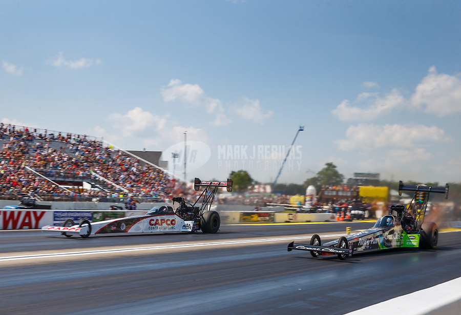 Aug 19, 2017; Brainerd, MN, USA; NHRA top fuel driver Steve Torrence (left) races alongside Clay Millican during qualifying for the Lucas Oil Nationals at Brainerd International Raceway. Mandatory Credit: Mark J. Rebilas-USA TODAY Sports