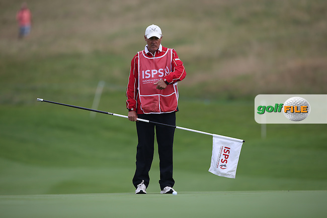 Caddie Patrik Sjoland (SWE) during Round Three of the ISPS Handa Wales Open 2014 from the Celtic Manor Resort, Newport, South Wales. Picture:  David Lloyd / www.golffile.ie