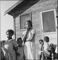 African American Family Near Houston, Texas by Dorothea Lange, 1939 (LOC) : TITLE: Colored family from near Houston, Texas. Been in California for two years. Husband came first, later sent for wife and two children, who traveled by bus (on licensed car, fare six dollars, traveling night and day). Husband now on Works Progress Administration (WPA)