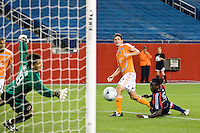 New England Revolution midfielder Shalrie Joseph (21) beats Houston Dynamo defender Eddie Robinson (2) and goalkeeper Pat Onstad (18) to score during overtime. The New England Revolution defeated the Houston Dynamo 2-2 (6-5) in penalty kicks in the SuperLiga finals at Gillette Stadium in Foxborough, MA, on August 5, 2008.