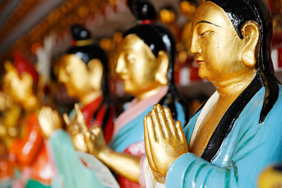 Praying figurines in main hall of the Ten Thousand Buddhas temple, Sha Tin, New Territories, Hong Kong SAR, People's Republic of China, Asia