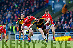 Daithi Casey, Dr Crokes in action against Liam Kearney, and Ronan Buckley, East Kerry during the Kerry County Senior Club Football Championship Final match between East Kerry and Dr. Crokes at Austin Stack Park in Tralee, Kerry.