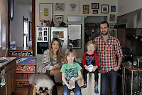 Patrick McNeil and Nicole Miziolek pose for a portrait with their children Denim McNeil, 6, and Bowie McNeil, 3. They moved from Williamsburg to Hastings-on-Hudson less than two years ago. ..Danny Ghitis for The New York Times