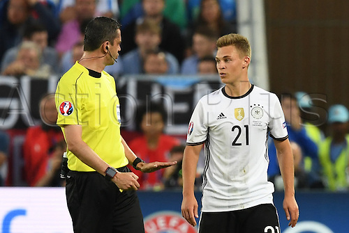 02.07.2016. Bordeaux, France. Germany's Joshua Kimmich talks to referee Viktor Kassai during the UEFA EURO 2016 quarter final soccer match between Germany and Italy at the Stade de Bordeaux in Bordeaux, France, 02 July 2016. Ph