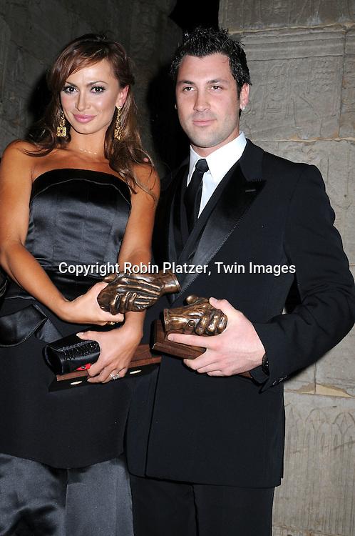 Karina Smirnoff and fiancee Maksim Chmerkovskiy with their awards