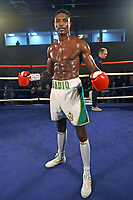 Umar Sadiq (white shorts) defeats Jevgenijs Andrejevs at the Woodside Leisure Centre on 9th March 2019