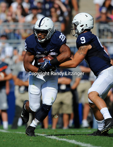 03 September 2016:  Penn State QB Trace McSorley (9) fakes a handoff and pulls the ball out from RB Saquon Barkley (26) 's stomach. The Penn State Nittany Lions defeated the Kent State Golden Flashes 33-13 at Beaver Stadium in State College, PA. (Photo by Randy Litzinger/Icon Sportswire)