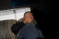 11/5/08- U.S. Mexico Border---  Mario Garcia Salcido sts on a couch at the Migrant Resource Center in Naco, Sonora. he was caught severl times by the Border Patrol while trying to cross into the US illigally. One of the tmes he crossed, he managed to climb the new fence with the help of a friend. (Pat Shannahan/ The Arizona Repubic)