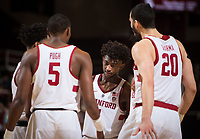 STANFORD, CA - January 26, 2019: Daejon Davis, Kodye Pugh, Josh Sharma at Maples Pavilion. The Stanford Cardinal defeated the Colorado Buffaloes 75-62.