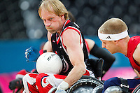 18 APR 2012 - LONDON, GBR - Canadian Garett Hickling (CAN) (Class 3.5) (left) races for the goal line pursued by Great Britain's Aaron Phipps (GBR) (Class 3.5) (right) during their London International Invitational Wheelchair Rugby Tournament match at the Olympic Park Basketball Arena in Stratford, London, Great Britain (PHOTO (C) 2012 NIGEL FARROW)
