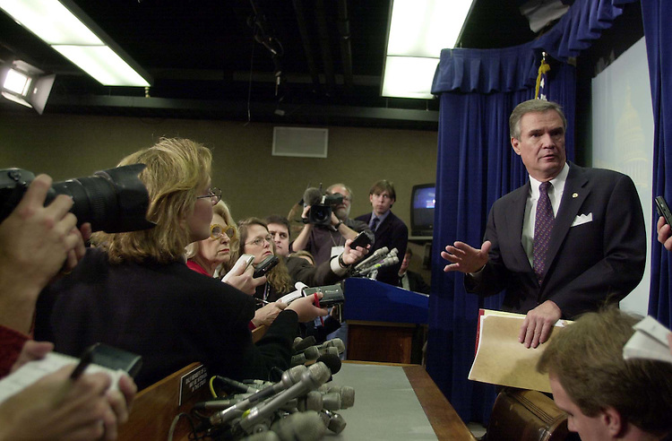 5leadership120500 -- John B. Breaux, D-La., talks with reporters after a press conference in the Senate Radio and T.V. gallery about the democratic deadership elections.
