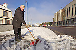 Brendan Dowling clears the snow from in front of his house in Saint Brendan's road Tralee.