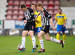 Dunfermline v St Johnstone..24.12.11   SPL .Martin Hardie and Jason Thomson close out Murray Davidson.Picture by Graeme Hart..Copyright Perthshire Picture Agency.Tel: 01738 623350  Mobile: 07990 594431