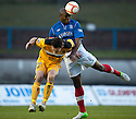 Cowdenbeath's Joe Mbu clears from Dumbarton's Jim Lister  ...