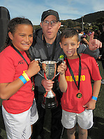 Waikato co-captains Paige Wilson (left) and Te Maia Huirama with coach Hone Waudby after winning the grand final on day two of the 2016 Air NZ Rippa Rugby Championship at Wakefield Park, Wellington, New Zealand on Tuesday, 23 August 2016. Photo: Dave Lintott / lintottphoto.co.nz