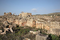 The House of the Oil Press and the Roman Basilica in the distance, Volubilis, Northern Morocco. There are 58 olive oil pressing places in the city. Volubilis was founded in the 3rd century BC by the Phoenicians and was a Roman settlement from the 1st century AD. Volubilis was a thriving Roman olive growing town until 280 AD and was settled until the 11th century. The buildings were largely destroyed by an earthquake in the 18th century and have since been excavated and partly restored. Volubilis was listed as a UNESCO World Heritage Site in 1997. Picture by Manuel Cohen