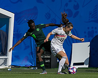 GRENOBLE, FRANCE - JUNE 22: Sara Daebritz #13 of the German National Team brings the ball forward as Chinwendu Ihezuo #19 of the Nigerian National Team defends during a game between Panama and Guyana at Stade des Alpes on June 22, 2019 in Grenoble, France.