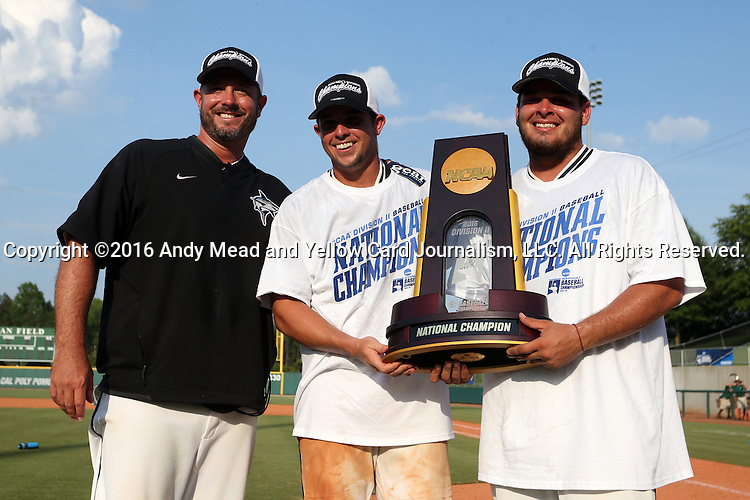 04 June 2016: Nova Southeastern head coach Greg Brown (left) and team captains Kavan Thompson (center) and Devin Raftery (right) pose with the championship trophy. The Nova Southeastern University Sharks played the Millersville University Marauders in Game 14 of the 2016 NCAA Division II College World Series  at Coleman Field at the USA Baseball National Training Complex in Cary, North Carolina. Nova Southeastern won the game 8-6 and clinched the NCAA Division II Baseball Championship.