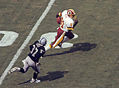 Washington Redskins wide receiver Art Monk (81) runs with the ball after a catch during the game against the Los Angeles Raiders at RFK Stadium in Washington, D.C. on September 14, 1986.  Pursuing Monk on the play is Raiders left cornerback Lester Hayes (37).<br /> Credit: Arnold Sachs / CNP