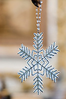 A Christmas decoration in the shape of a snow flake