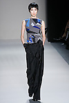 Tao Okamoto walks the runway in a Nicole Miller Fall 2011 outfit, during Mercedes-Benz Fashion Week.