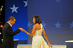 Barack and Michelle Obama at the Home States Ball, part of the inauguration festivities after Barack Obama was sworn in as the 44th U.S. President, at the Washington Convention Center in Washington, DC on January 20, 2009.  Michelle Obama's dress is designed by Jason Wu, a Taiwanese-born New York designer whose clothes Michelle has previously worn.