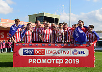 Lincoln City players celebrate after securing promotion from Sky Bet League Two<br /> <br /> Photographer Chris Vaughan/CameraSport<br /> <br /> The EFL Sky Bet League Two - Lincoln City v Cheltenham Town - Saturday 13th April 2019 - Sincil Bank - Lincoln<br /> <br /> World Copyright &copy; 2019 CameraSport. All rights reserved. 43 Linden Ave. Countesthorpe. Leicester. England. LE8 5PG - Tel: +44 (0) 116 277 4147 - admin@camerasport.com - www.camerasport.com