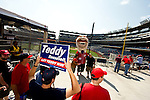 Washington Nationals fans take photos with Teddy Roosevelt during a game against the Miami Marlins at Nationals Park in Washington, DC on September 8, 2012.
